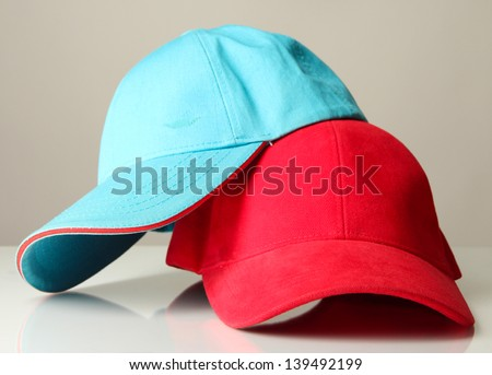 Red and blue caps cap isolated on white - stock photo