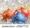 Red and blue christmas balls over blurry background. Shallow depth of field - stock photo