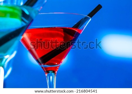 red and blue cocktail on light disco background with space for text, dance disco concept