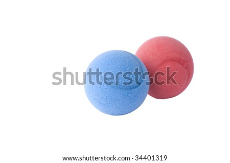 Red and blue foam balls on  white - stock photo