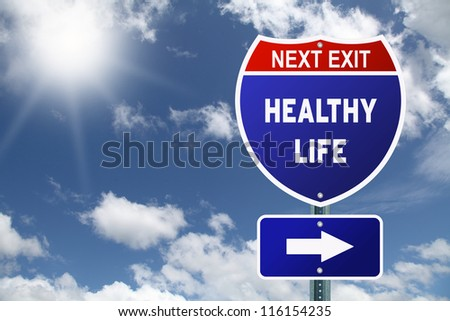 Red and blue interstate road sign Next Exit Healthy life - stock photo