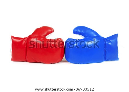 Red and blue leather boxing gloves isolated on white.