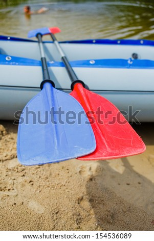 Red and blue paddles for white water rafting and kayaking - stock photo
