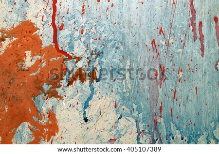 Red and blue paint splashes on grunge wall. Abstract  backdrop for your design - stock photo