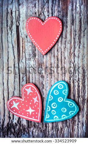 Red and blue paper heart on wooden background, Blank pink paper note with heart shape on grunge blue wooden background with copy space - stock photo