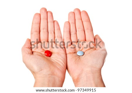 Red and blue pills in woman hands. Isolated on white background - stock photo