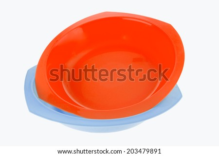 Red  and blue plastic dish isolated on white background - stock photo