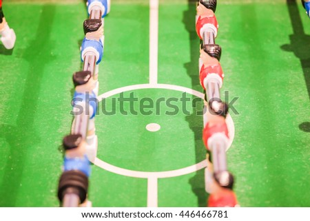 Red and blue player on football table game, soccer table game from top down, Sport Background concept, Selective focus in middle of circle - stock photo