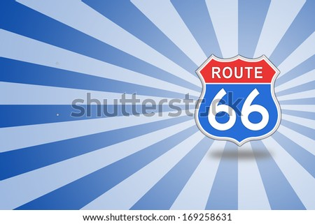 Red and blue Route 66 Road Sign isolated on blue sunbeam background with copy space. - stock photo