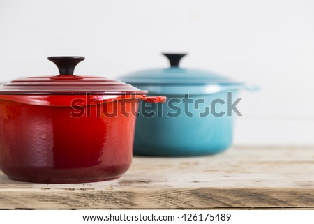 Red and blue saucepans - stock photo
