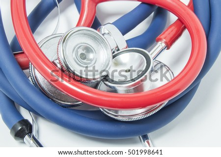 Red and blue stethoscopes is wound into ball. The concept of photo that symbolizes hard diagnosis, difficulties or problems with diagnostics of disease, as well as connection, unity, love in medicine