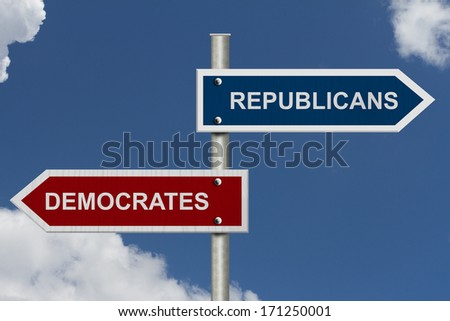 Red and blue street signs with blue sky with words Republicans and Democrats, Republicans versus Democrats - stock photo