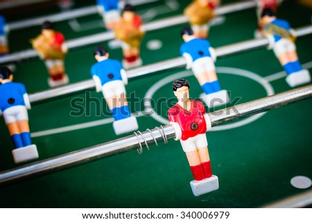 red and blue table soccer players, selective focus.