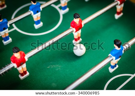 red and blue table soccer players, selective focus. - stock photo