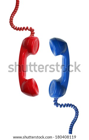 Red and Blue telephone recievers - stock photo