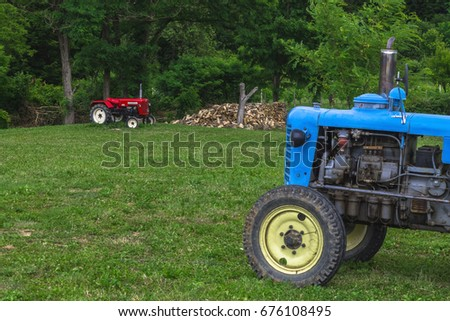 Red and blue tractor in the field
