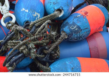 Red and Blue well used lobster floats on a dock in Maine - stock photo