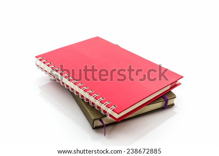 Red and brown diary book on white background.
