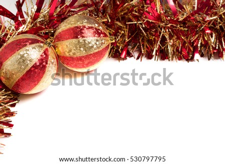 Red and Gold Christmas decorations with baubles and shiny garland with copy space