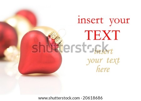 Red and gold christmas ornaments on white background and place for sample text - stock photo