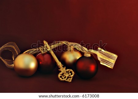 red and gold christmas ornaments with gold glittering key - stock photo
