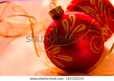 Red and gold Christmas ornaments with gold ribbon