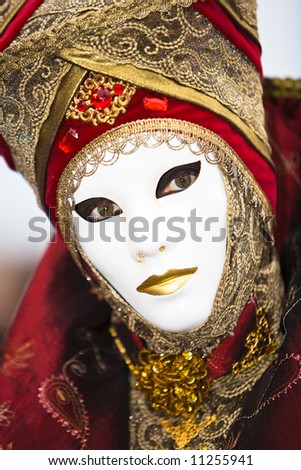 Red and gold costume at the Venice Carnival
