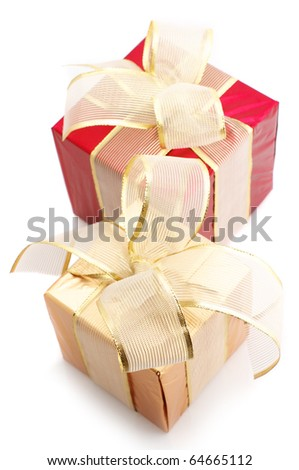 Red and gold foil gifts with golden bows isolated on white background. - stock photo
