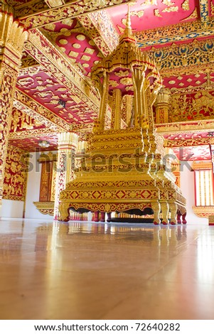 Red and Gold Interior of Ho Prabang Temple Near the Royal Palace Museum in Luang Prabang, Laos, Southeast Asia - stock photo
