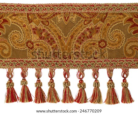 Red and Gold Tassels with Trim on Fabric  - stock photo