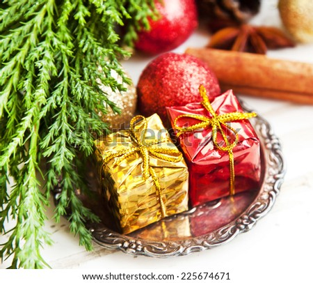 Red and Golden Christmas Gifts, Glitter Globes and Decoration with Fir Tree  - stock photo