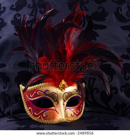 red and golden mask (Venice)  black velvet background - stock photo