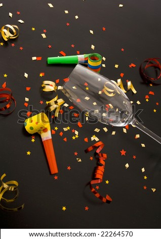 red and golden spirals, small confetti stars, blowers and flute , party time - stock photo