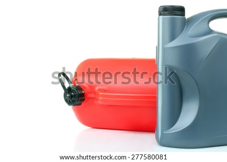 red and gray canisters of gasoline in isolated