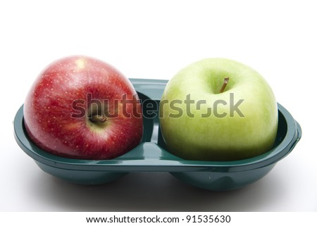 Red and green apple in the packaging