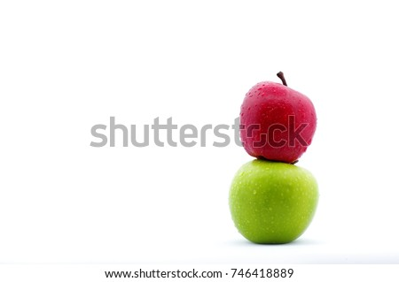 red and green apple on top of each other isolated in white background