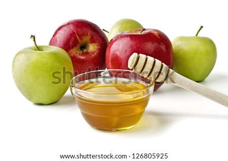 Red and green apples and a bowl of honey over white. Illustration of Rosh Hashanah (jewish new year) or Savior of the Apple Feast Day - stock photo