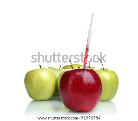 red and green apples and syringe isolated on white - stock photo