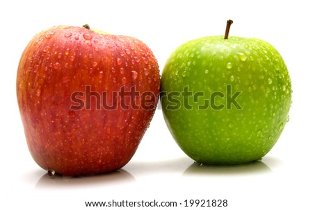 Red and green apples covered by water drops on the white background. Isolated.