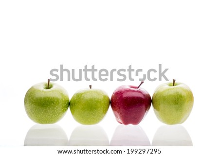 red and green apples in a row
