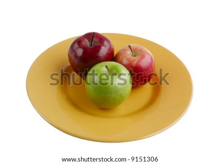 Red and Green Apples on Bright Yellow Plate Isolated on White Background