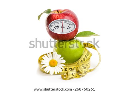 red and green apples with measuring tape and weight scale  Isolated on white background. Diet concept. - stock photo