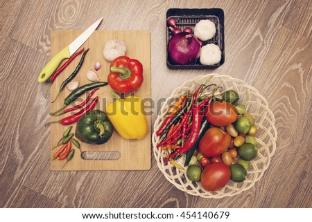 Red and green chili pepper, paprika and other spices - stock photo