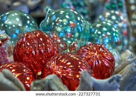 Red and Green Christmas Ornaments in a Wooden Basket. - stock photo