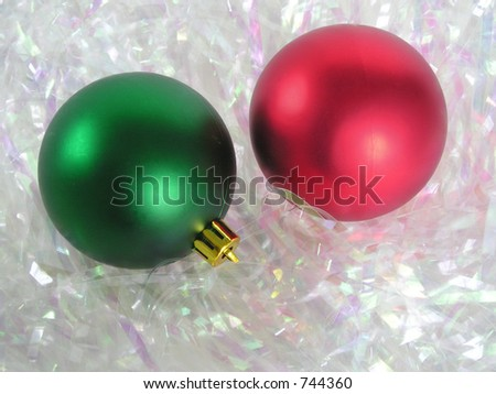 Red and green christmas ornaments on a sparkle background