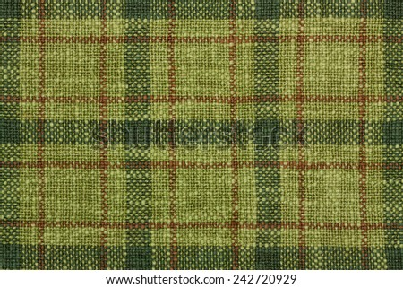 Red and green Christmas tartan. - stock photo
