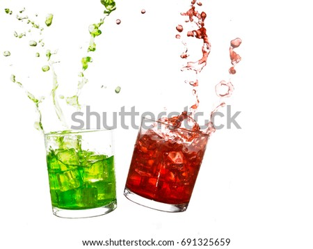 Red and green cold drinks with splashes and ice. Summer refreshment. Isolated own white.