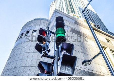 Red and green colors on the traffic light in Montreal downtown. - stock photo