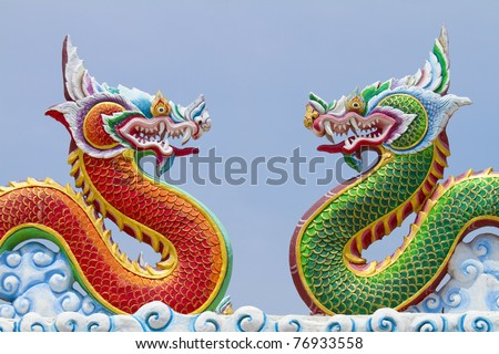 Red and green dragon on the roof of a Chinese temple in Thailand. - stock photo