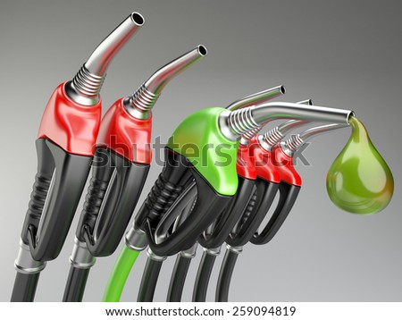 Red and green gas pump nozzle with drop oil. 3d illustration isolated on a gray background. - stock photo